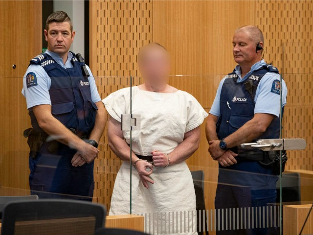 The man charged in relation to the Christchurch massacre Brenton Tarrant gestures in the dock for his appearance for mur