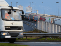 CALAIS, FRANCE - MARCH 06: A line of trucks snakes along an access road leading towards the port of Calais on March 06, 2019 in Calais, France. Delays have increased as customs agents work-to-rule in a bid to receive more pay, ahead of the prospects of a demanding period during …