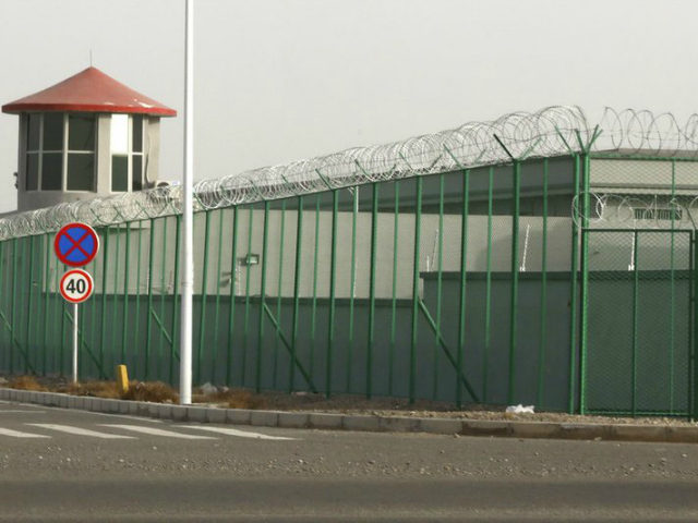 In this Monday, Dec. 3, 2018, photo, a guard tower and barbed wire fences are seen around a facility in the Kunshan Industrial Park in Artux in western China's Xinjiang region. This is one of a growing number of internment camps in the Xinjiang region, where by some estimates 1 …