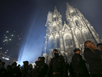 COLOGNE, GERMANY - JANUARY 1: Visitors celebrate New Year's Eve as police stand guard in front of Cologne Cathedral, not far from where on New Year's Eve one year ago hundreds of apparently coordinated sexual assaults were perpetrated against women, on January 1, 2017 in Cologne, Germany. City authorities have …