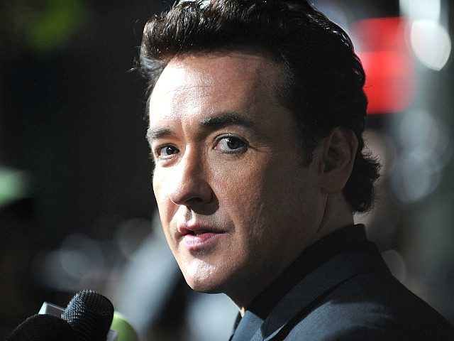 """LOS ANGELES, CA - NOVEMBER 03: Actor John Cusack arrives at the premiere of Columbia Pictures' """"2012"""" at the Regal Cinemas LA live on November 3, 2009 in Los Angeles, California. (Photo by Alberto E. Rodriguez/Getty Images)"""