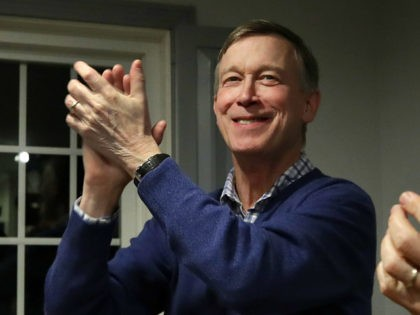 FILE - In this Feb. 13, 2019, file photo, former Colorado Gov. John Hickenlooper, left, applauds at a campaign house party, in Manchester, N.H. Hickenlooper is running for president, becoming the second governor to jump into the sprawling Democratic 2020 contest. Hickenlooper is a former brewpub owner and Denver mayor …