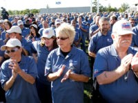 Ford employees applaud at an event that celebrates the opening of the new U.S. production line where the 2013 Ford Fusion midsize sedan will be made at the Flat Rock Assembly Plant September 10, 2012 in Flat Rock, Michigan.