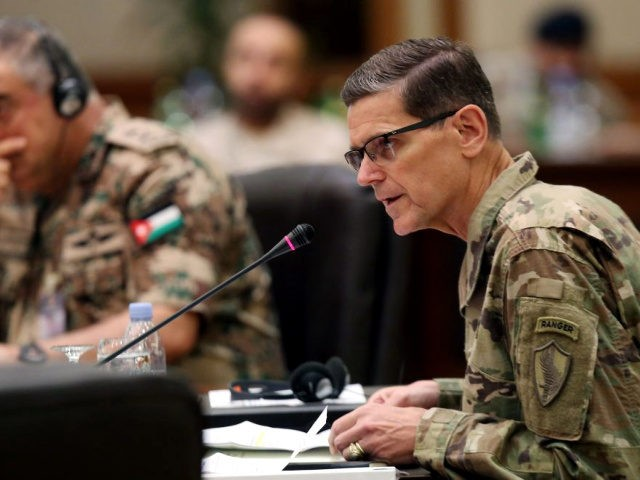 Commander of United States Central Command Joseph Leonard Votel (R), speaks during a meeting with the Gulf cooperation council's armed forces chiefs of staff in Kuwait City on September 12, 2018.