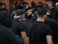 BERLIN, GERMANY - SEPTEMBER 13: Police watch as mourners arrive for the funeral of Nidal R., an associate of a Berlin Arab clan, outside the New 12 Apostles cemetery on September 13, 2018 in Berlin, Germany. Nidal R., 36, a multiple felon, was gunned down by assailants who managed to …