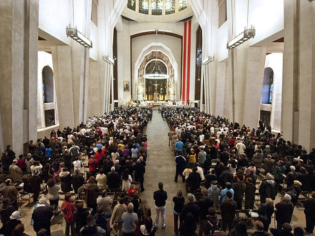 "This October 17, 2010 photo worshippers during a solemn mass inside Saint Joseph's Oratory basilica in Montreal, Quebec, Canada. More than 1,000 Quebecers gathered Sunday at a Roman Catholic basilica in Montreal to watch their beloved Brother Andre enter the sainthood at the Vatican, calling it a ""message of hope."" …"