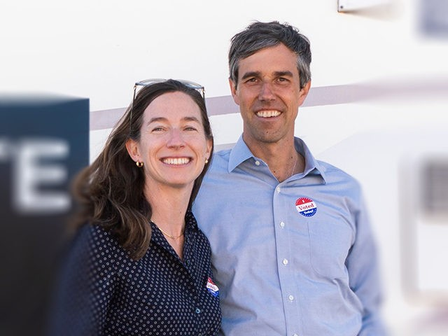 Texas Senatorial Candidate Congressman Beto ORourke and his wife, Amy Hoover Sanders, are pictured in front of a campaign RV outside of Nixon Elementary School in El Paso, Texas, on November 6, 2018. - Americans started voting Tuesday in critical midterm elections that mark the first major voter test of …