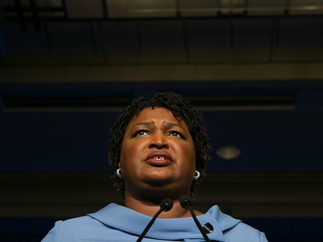 ATLANTA, GA - NOVEMBER 06: Democratic Gubernatorial candidate Stacey Abrams addresses supporters at an election watch party on November 6, 2018 in Atlanta, Georgia. Abrams and her opponent, Republican Brian Kemp, are in a tight race that is too close to call. A runoff for Georgia's governor is likely. (Photo …