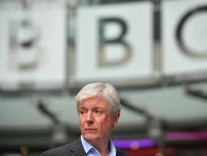 Director-General of the BBC Tony Hall is seen waiting to greet Britain's Prince William, Duke of Cambridge, and Britain's Catherine, Duchess of Cambridge, as the royal couple visit BBC Broadcasting House in London on November 15, 2018 to view the work the broadcaster is doing as a member of The …