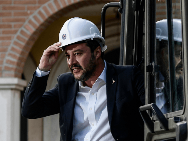 Italys Interior Minister and deputy PM Matteo Salvini stands on a bulldozer as he prepares to preside over the demolition of some of eight illegally built villas seized by Rome police to the Casamonica mafia clan in the south-eastern suburb Quadraro district of Rome on November 26, 2018. (Photo by …