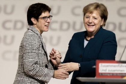 HAMBURG, GERMANY - DECEMBER 7: Annegret Kramp-Karrenbauer and Angela Merkel (R) react after after Kamp-Karrenbauer received the most votes to become the next leader of the German Christian Democrats (CDU) at a federal congress of the CDU on December 7, 2018 in Hamburg, German Chancellor and leader of the German …