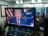 US President Donald Trump appears on a television screen in the Press Briefing Room of the White House in Washington, DC, on January 8, 2019, as he speaks during a presidential address about the government shutdown and border security from the Oval Office. - Trump demanded $5.7 billion to fund …