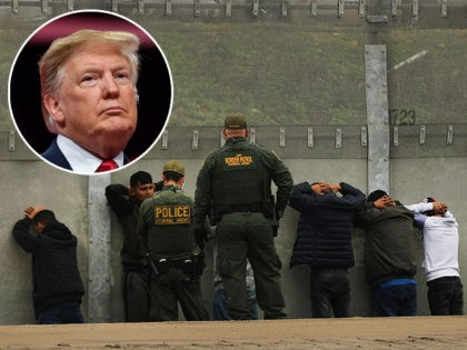 TIJUANA, MEXICO - JANUARY 17: Men surrender to United States Border Patrol agents after jumping a fence in an attempt to get into America on January 17, 2019 in Tijuana, Mexico. Tijuana has experienced a surge in Central Americans seeking to cross the border into America. The U.S. government is …