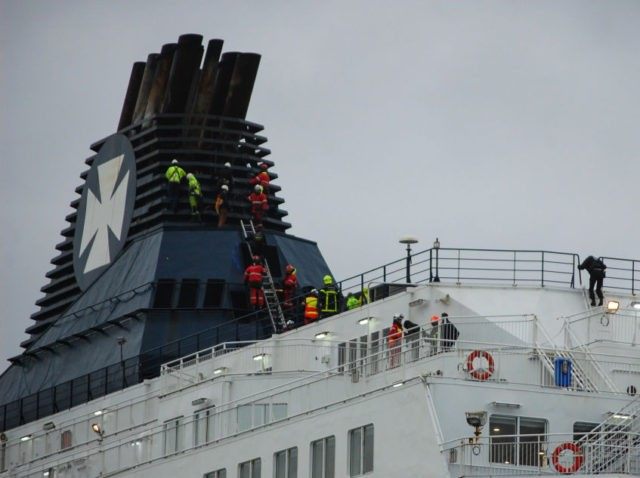 Migrants storm UK-bound ferry at port of Calais