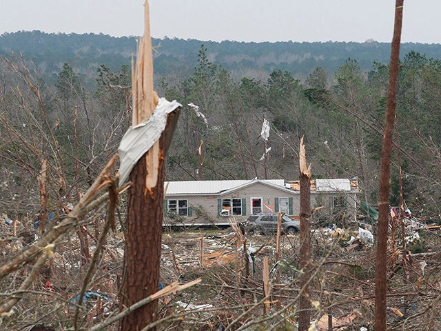 "Damage is seen from a tornado which killed at least 23 people in Beauregard, Alabama on March 4, 2019. - Rescuers in Alabama were set to resume search operations Monday after at least two tornadoes killed 23 people, uprooted trees and caused ""catastrophic"" damage to buildings and roads in the …"