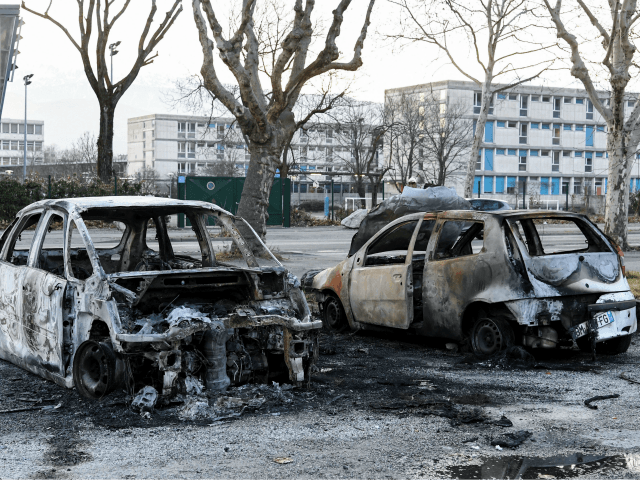 This picture taken on March 5, 2019 shows two burnt cars in the street where riots sparked last night, for the third night in a row, following the death of 2 young people on a scooter as they were chased by the police on March 2, in Grenoble central-eastern France. …