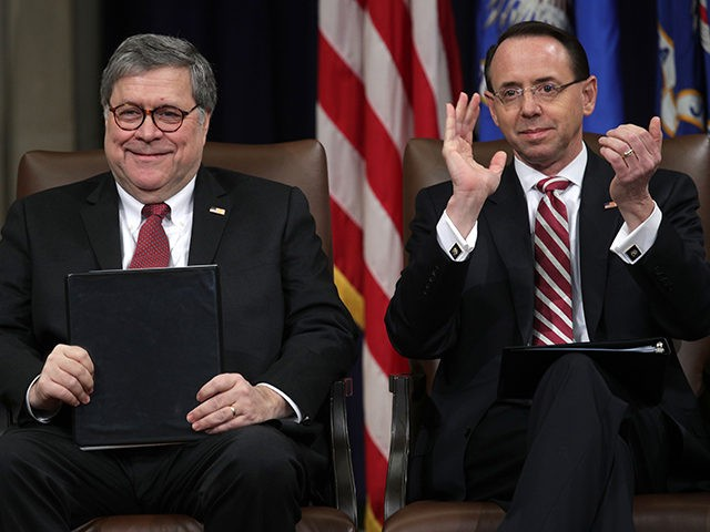 WASHINGTON, DC - FEBRUARY 26: U.S. Attorney General William Barr (L) and Deputy Attorney General Rod Rosenstein (R) attend a Department of Justice African American History Month Observance Program at the Department of Justice February 26, 2019 in Washington, DC. (Photo by Alex Wong/Getty Images)