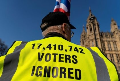 "Pro-Brexit activists demonstrate near the Houses of Parliament in central London on March 29, 2019. - British MPs on Friday rejected Prime Minister Theresa May's EU divorce deal for a third time, opening the way for a long delay to Brexit -- or a potentially catastophic ""no deal"" withdrawal in …"