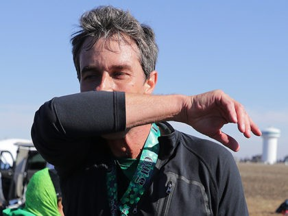 NORTH LIBERTY, IOWA - MARCH 16: Democratic presidential candidate Beto O'Rourke wipes away sweat after finishing the Lucky Run 5k race March 16, 2019 in North Liberty, Iowa. After losing a long-shot race for U.S. Senate to Ted Cruz (R-TX), the 46-year-old O'Rourke is making his first campaign swing through …