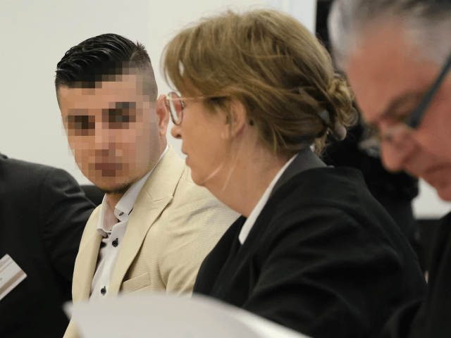 DRESDEN, GERMANY - MARCH 18: (EDITORS NOTE: Part of this image has been pixellated to obscure the identity of the defendant) Alaa S. (L) sits with his lawyers Ricarda Lang and Frank Wilhelm Drücke as he arrives in court for the first day of his trial for the possible murder …