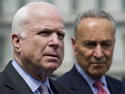 US Senator Chuck Schumer (R)D-NY, and Senator John McCain, R-AZ, speak to the media outside of the West Wing of the White House in Washington, DC, July 11, 2013, following a meeting regarding immigration reform with US President Barack Obama. AFP PHOTO / Saul LOEB (Photo credit should read SAUL …