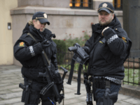 Armed police officers are seen outside the Nobel institute in Oslo on December 9, 2014. Due to a heightened terror alert the police have responded by instructing its officers to carry weapons throughout the Christmas season. AFP PHOTO / ODD ANDERSEN (Photo credit should read ODD ANDERSEN/AFP/Getty Images)