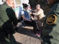 LA GRULLA, TX - DECEMBER 10: A U.S. Border Patrol medic takes the blood pressure of an undocumented immigrant who needed medical attention after being caputured near the U.S.-Mexico border on December 10, 2015 at La Grulla, Texas. She was diagnosed with hypertention and taken into custody. The number of …