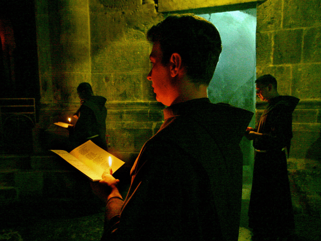 JERUSALEM, -: A Franciscan monk prays during a procession at the Saint Sepulchre in Jerusalem 24 August 2005. AFP PHOTO/ NICOLAS ASFOURI (Photo credit should read NICOLAS ASFOURI/AFP/Getty Images)