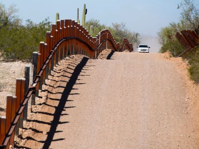 Tucson Sector Border Patrol agents patrol outdated vehicle border barriers where large groups of Central American illegal aliens continue to cross the border. (File Photo: JIM WATSON/AFP/Getty Images)