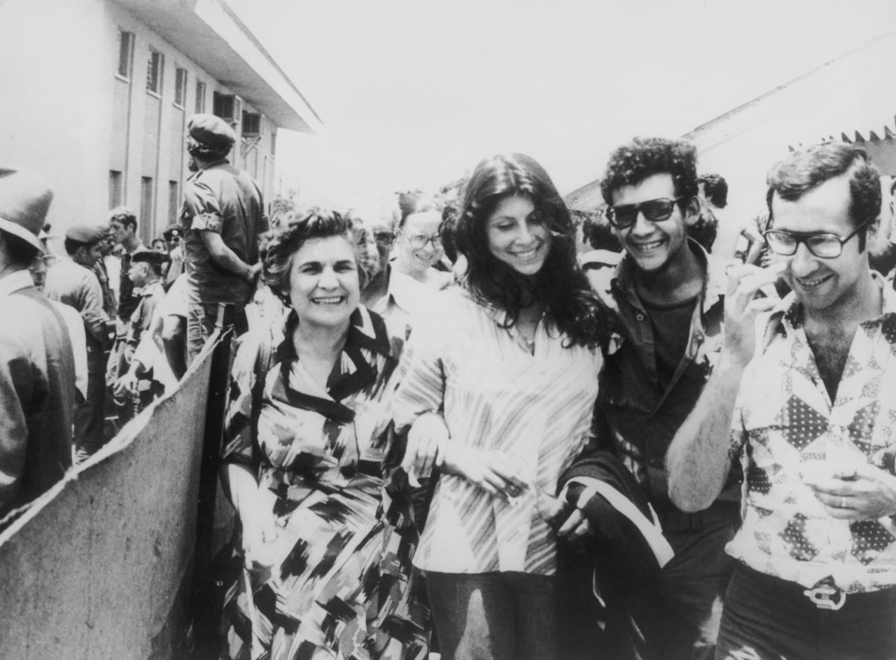 Israeli hostages on their return to Israel after Operation Entebbe on 3rd July 1976, in which, Israeli special forces rescued 100 hostages held at Entebbe Airport in Uganda by members of the Popular Front for the Liberation of Palestine following their hijack of Air France Flight 139. (Photo by Keystone/Hulton Archive/Getty Images)