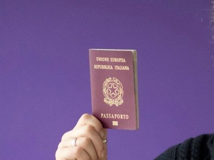 Dimitri Scarlato, an Italian composer and conductor lecturing at the Royal College of Music in London poses with his Italian passport at his home, on January 14, 2018. On Brexit he says: 'Brexit changed my perception of living in this country. The only positive outcome of Brexit -- I really …