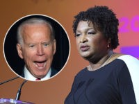 (INSET: Joe Biden) NEW ORLEANS, LA - JULY 07: Stacey Abrams speaks onstage during the 2018 Essence Festival presented by Coca-Cola at Ernest N. Morial Convention Center on July 7, 2018 in New Orleans, Louisiana. (Photo by Paras Griffin/Getty Images for Essence)