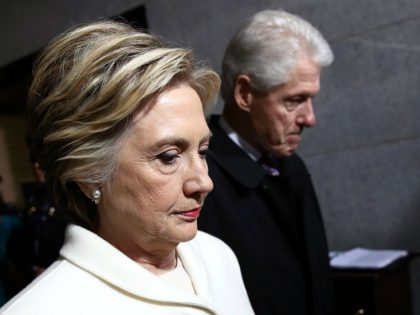 Former Democratic presidential nominee Hillary Clinton and former US President Bill Clinton arrive on the West Front of the US Capitol on January 20, 2017 in Washington, DC.Donald Trump took the first ceremonial steps before being sworn in as the 45th president of the United States Friday -- ushering in …