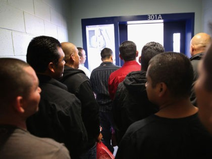 Immigrants prepare to be set free from the Adelanto Detention Facility on November 15, 2013 in Adelanto, California. The center, the largest and newest Immigration and Customs Enforcement (ICE), detention facility in California, houses an average of 1,100 immigrants in custody pending a decision in their immigration cases or awaiting …
