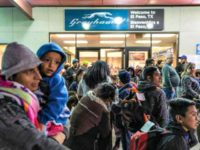 Asylum-seekers wait at a Greyhound bus station in El Paso, Texas, after being dropped off by Immigration and Customs Enforcement, on Dec. 23, 2018. (PAUL RATJE/AFP/Getty Images)