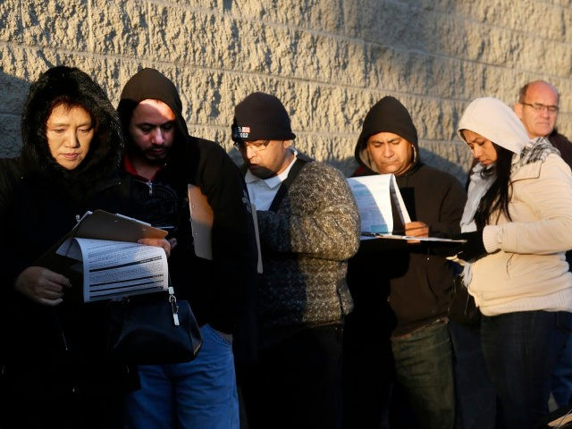 Immigrants line up after spending the night outside a California Department of Motor Vehicles office to register for drivers licenses in Stanton, Calif., Friday, Jan. 2, 2015.