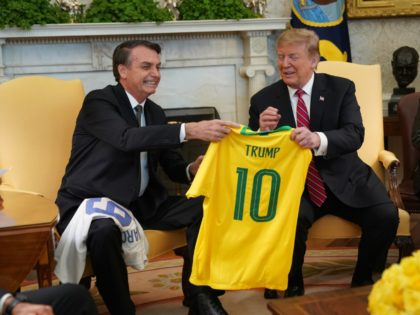 Brazilian President Jair Bolsonaro presents U.S. President Donald Trump with a Brazil national soccer team jersey Number 10 for striker position at the White House March 19, 2019 in Washington, DC. President Trump is hosting President Bolsonaro for a visit and bilateral talks at the White House today. (Photo by …