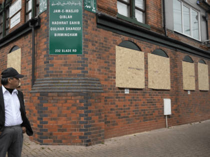 BIRMINGHAM, ENGLAND - MARCH 21: People view damage to Jam-E-Masjid Qiblah Hadhrat Sahib Gulhar Shareef mosque on Slade Road after a hammer attack last night braking it's windows last night, on March 21, 2019 in Birmingham, England. Anti-terror police have being called in to investigate the hammer attcaks on five …