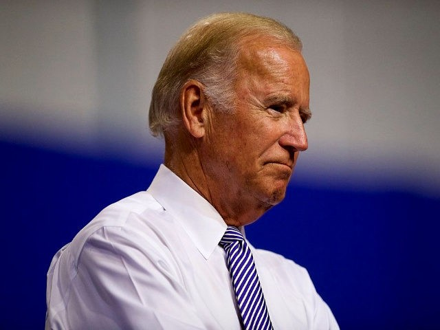 US Vice President Joe Biden listens as Democratic Presidential candidate Hillary Clinton delivers remarks at Riverfront Sports athletic facility on August 15, 2016 in Scranton, Pennsylvania. Hillary Clinton focused her speech on the economy and bringing jobs to the key swing state of Pennsylvania.