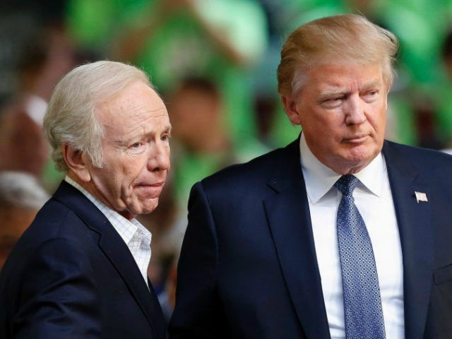 Former Democratic vice presidential candidate, former Connecticut Sen. Joe Lieberman, an No Labels co-chairman, introduces Republican presidential candidate Donald Trump to speak at a No Labels Problem Solver convention, Monday, Oct. 12, 2015, in Manchester, N.H. (AP Photo/Jim Cole)