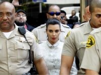 LOS ANGELES, CA - APRIL 12: Kim Kardashian surrounded by Los Angeles County Sheriff Deputies leaves the Stanley Mosk Courthouse after attending her divorce hearing from Kris Humphries on April 12, 2013 in Los Angeles, California. Kim Kardashian and NBA player Kris Humphries are appearing for divorce proceedings. Humphries is …