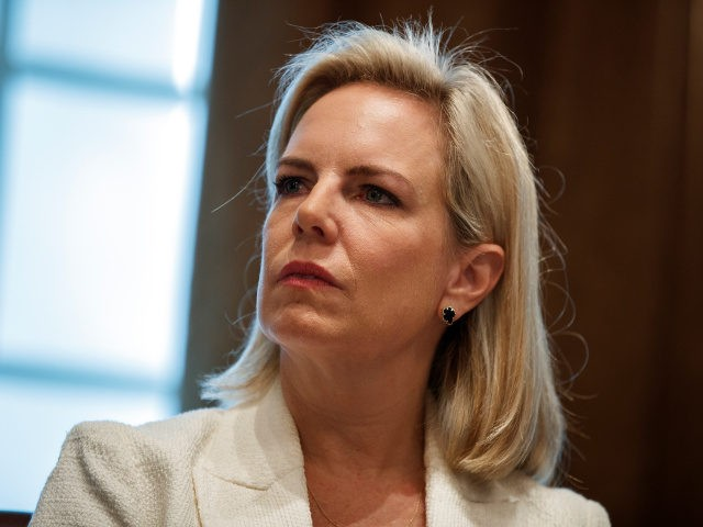 Secretary of Homeland Security Kirstjen Nielsen listens as President Donald Trump speaks during an event on human trafficking in the Cabinet Room of the White House, Friday, Feb. 1, 2019, in Washington.