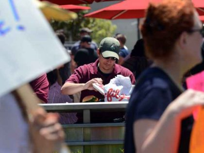 Man enjoying Chick-fil-A during Protest