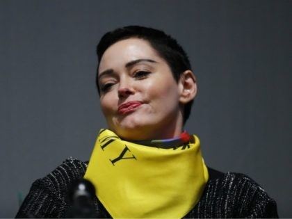Actress Rose McGowan speaks on a panel at the inaugural Women's Convention in Detroit, Friday, Oct. 27, 2017. McGowan recently went public with her allegation that film company co-founder Harvey Weinstein raped her. (AP Photo/Paul Sancya)