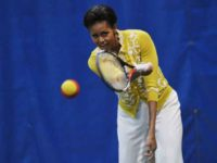 Michele Obama playing tennis