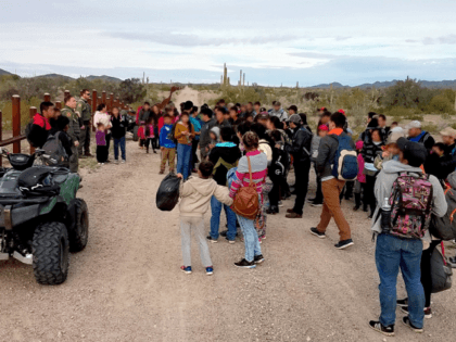Ajo Station Border Patrol agents apprehend a large group of migrants who illegally crossed the border west of the Lukeville Port of Entry. (Photo: U.S. Border Patrol/Tucson Sector)