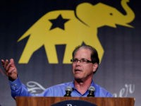 Republican U.S. Senate candidate Mike Braun speaks at the Indiana Republican Party Fall Dinner in Indianapolis, Friday, Oct. 12, 2018. (AP Photo/Michael Conroy)