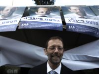 Moshe Feiglin, ruling rightwing Likud party candidate, leaves a polling station after casting his vote on November 25, 2012 in Jerusalem, in his party's leadership primary ahead of a general election on January 22. According to army radio, Prime minister Netanyahu has been putting pressure on his supporters to work …