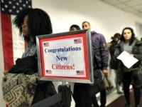 Immigrants wait in line to become U.S. citizens at a naturalization ceremony on February 2, 2018 in New York City. U.S. Citizenship and Immigration Services (USCIS) swore in 128 immigrants from 42 different countries during the ceremony at the downtown Manhattan Federal Building. (Photo by John Moore/Getty Images)