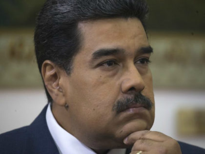 Venezuela's President Nicolas Maduro listens during an interview with The Associated Press at Miraflores presidential palace in Caracas, Venezuela, Thursday, Feb. 14, 2019. Even while criticizing Donald Trump's confrontational stance toward his socialist government, Maduro said he holds out hope of meeting the U.S. president to resolve an impasse over …